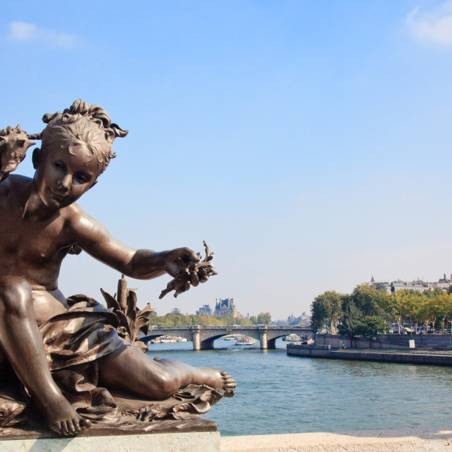 """Small child statue frames view of Seine and Paris"" stock image"