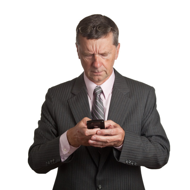 """Senior with blackberry"" stock image"