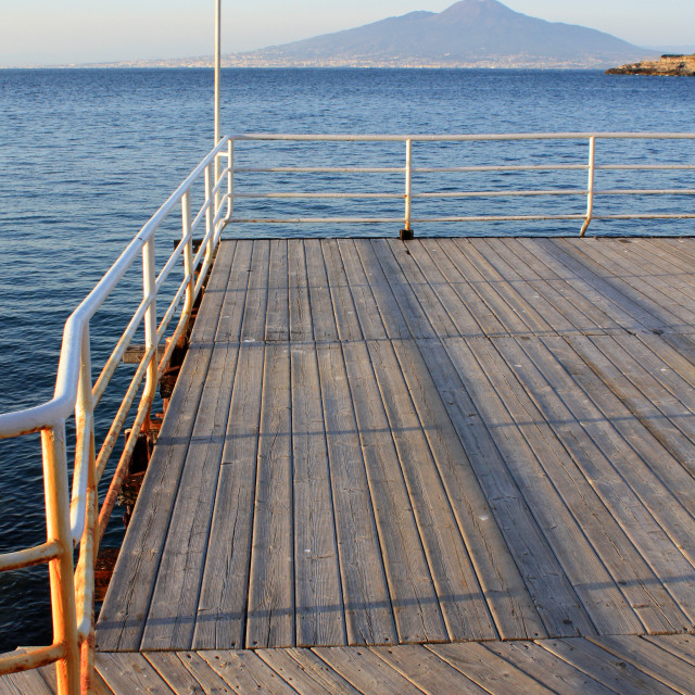 """Pier towards the volcano"" stock image"