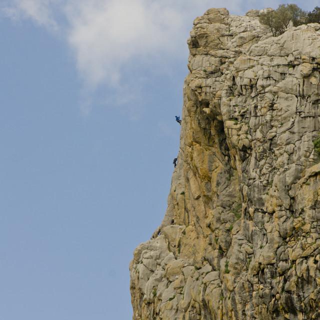 """Tiny Rock climbers"" stock image"