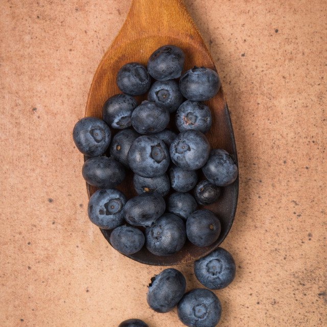 """Blueberries on a wooden spoon"" stock image"