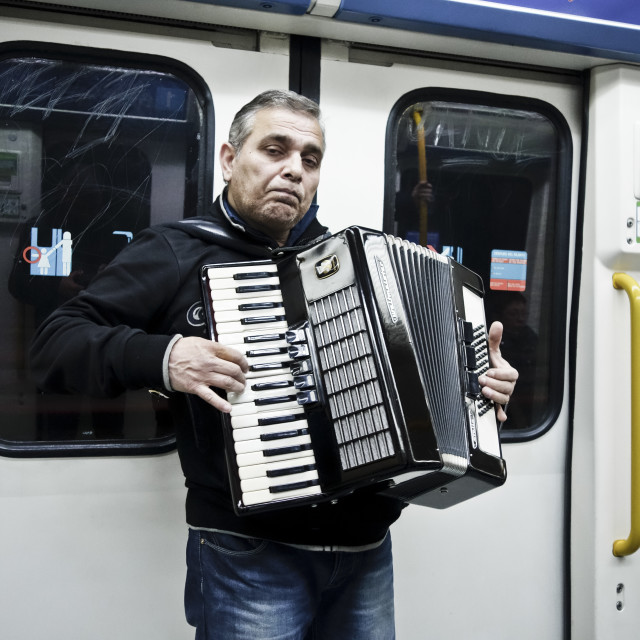 """Street musician with accordion"" stock image"
