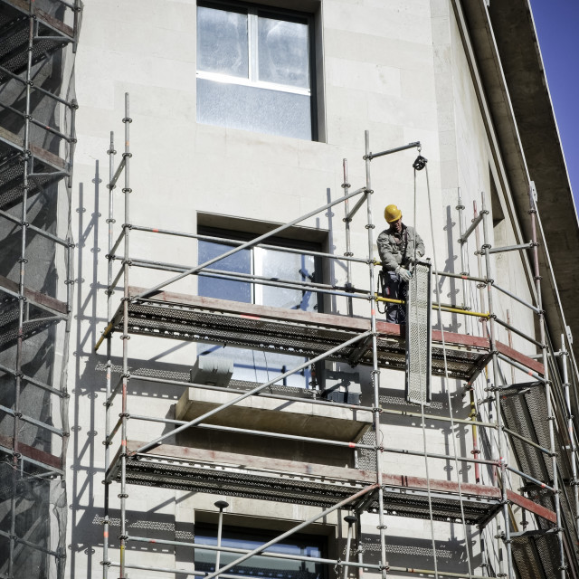 """Scaffolding and workman"" stock image"