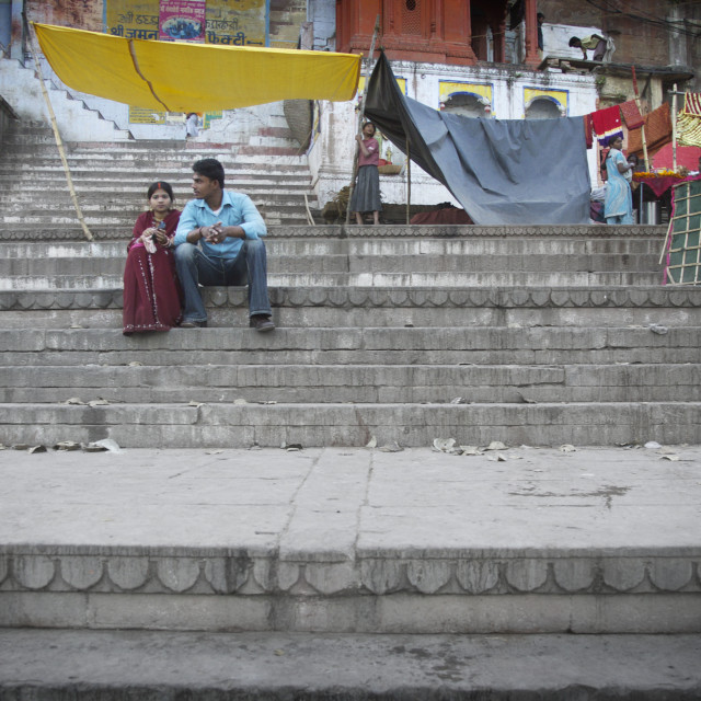 """Boyfriend & girlfriend on the steps in Varanasi"" stock image"