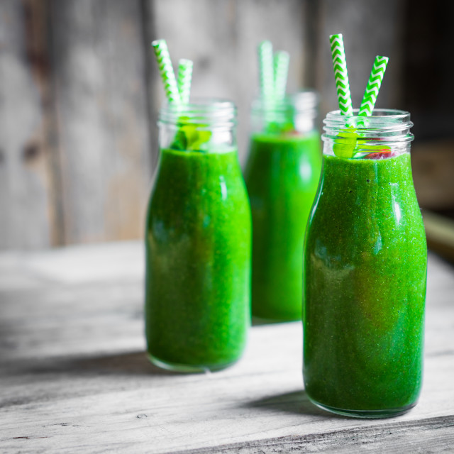 """Fresh green smoothie on rustic wooden background"" stock image"