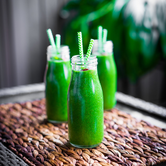 """Fresh green smoothie outdoors"" stock image"