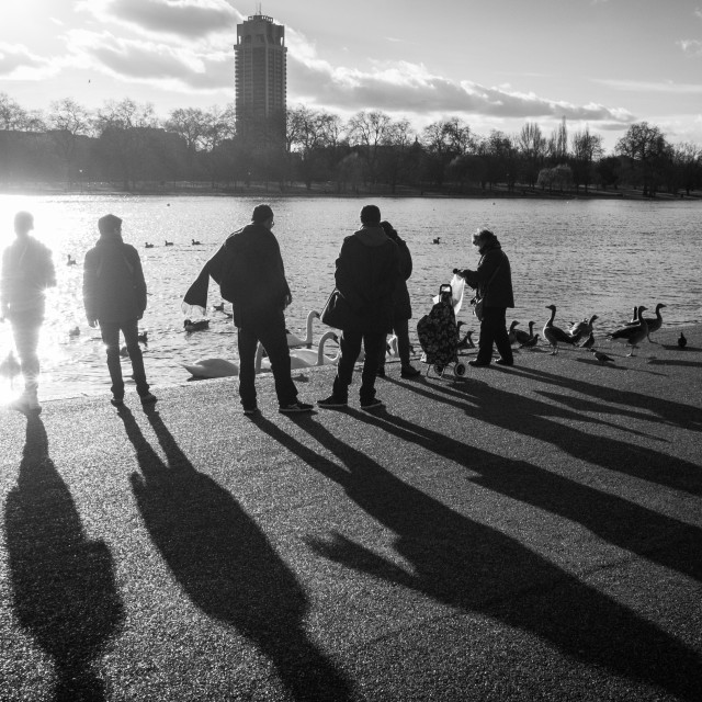 """People at the lake in the winter sun"" stock image"