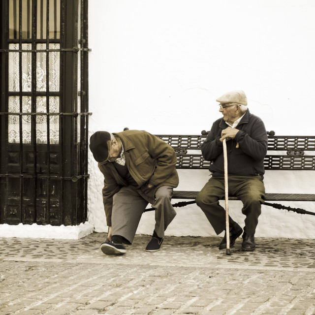 """Two retired man in Spanish village"" stock image"