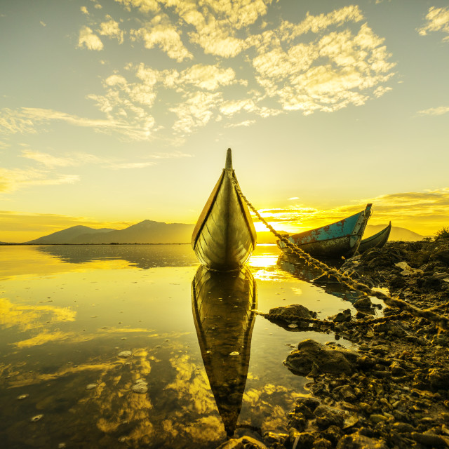 """Sunrise like gold on the water"" stock image"