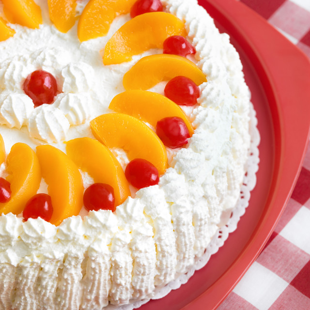 """Homemade cream cake with peaches and cherries"" stock image"
