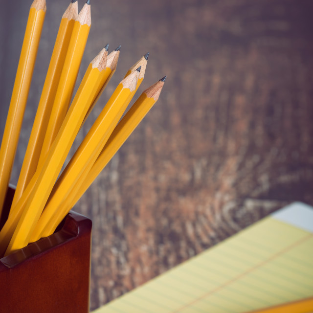 """Group of yellow pencils in pencil holder"" stock image"