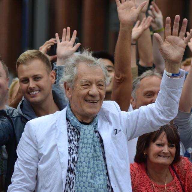 """Sir Ian McKellen waving with crowd"" stock image"