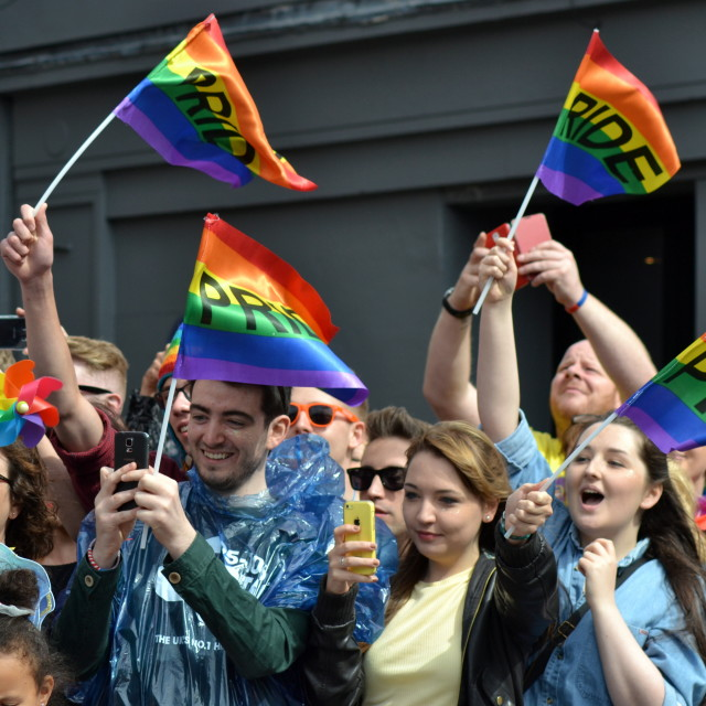 """Crowd watching Manchester Pride parade waving"" stock image"