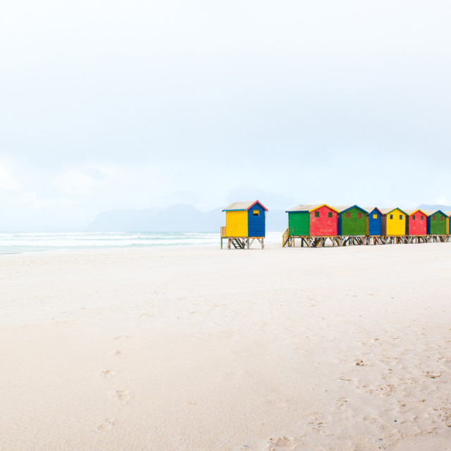 """Colourful bathing huts on a beach in winter"" stock image"