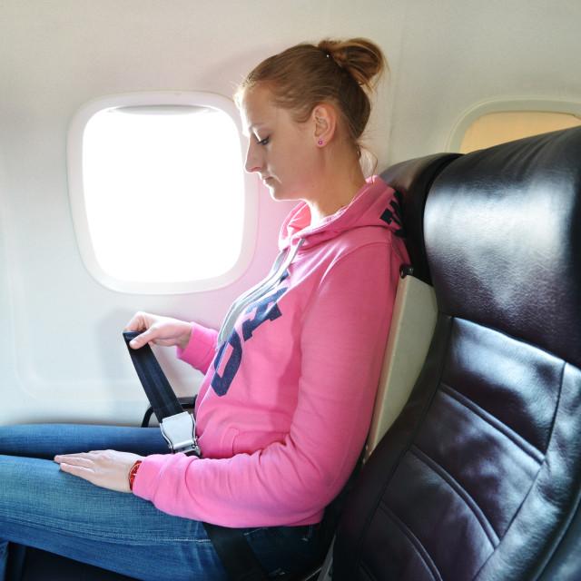 """Girl fastening her seat belt"" stock image"