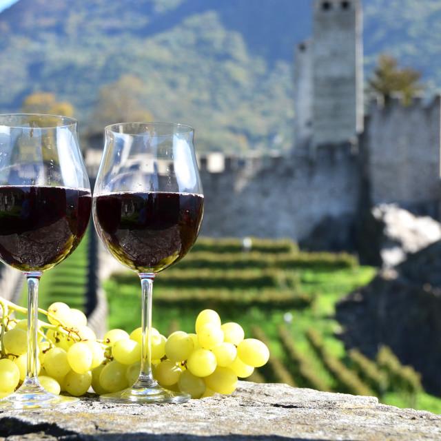 """Pair of wineglasses and grapes. Bellinzona, Switzerland"" stock image"