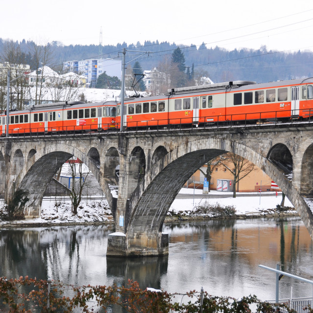 """Train crossing ancient bridge"" stock image"