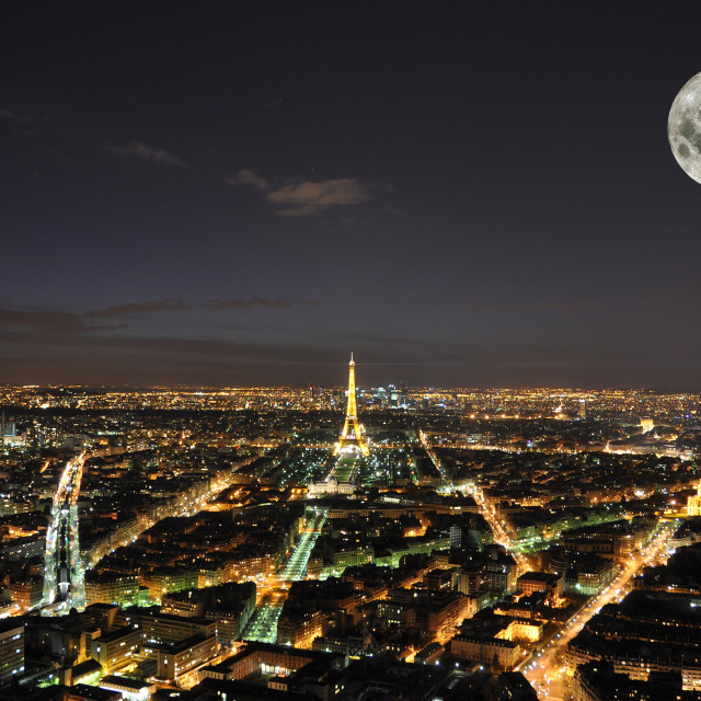 """""""PARIS - APRIL 4: Eiffel Tower at night April 4, 2010 in Paris, France. The Eiffel tower is the most visited monument of France and the most recognizable landmark of the world"""" stock image"""