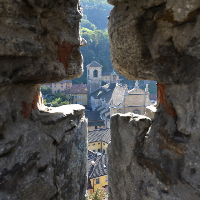 """View to Bellinzona town through the ancient arrow-loop"" stock image"