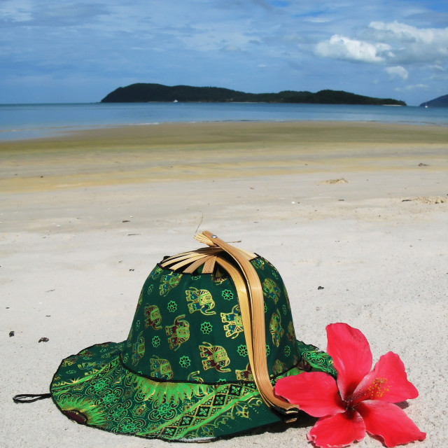 """""""Hat on the sandy beach. Langkawi, Malaysia"""" stock image"""