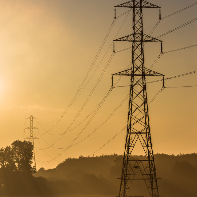 """Golden Sunrise Electricity Pylons"" stock image"