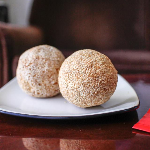 """Chinese sesame balls on white plate"" stock image"