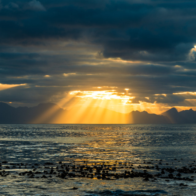 """""""Sun breaking theough thick clouds"""" stock image"""