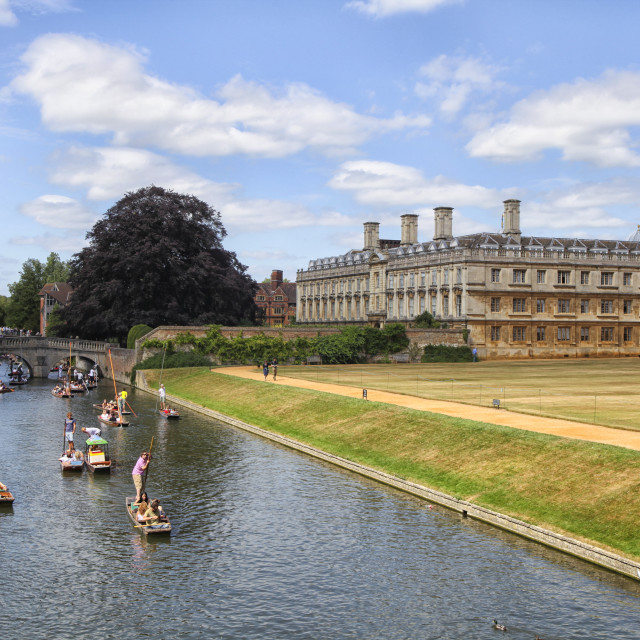 """Punter boats passing King's college in Cambridge"" stock image"
