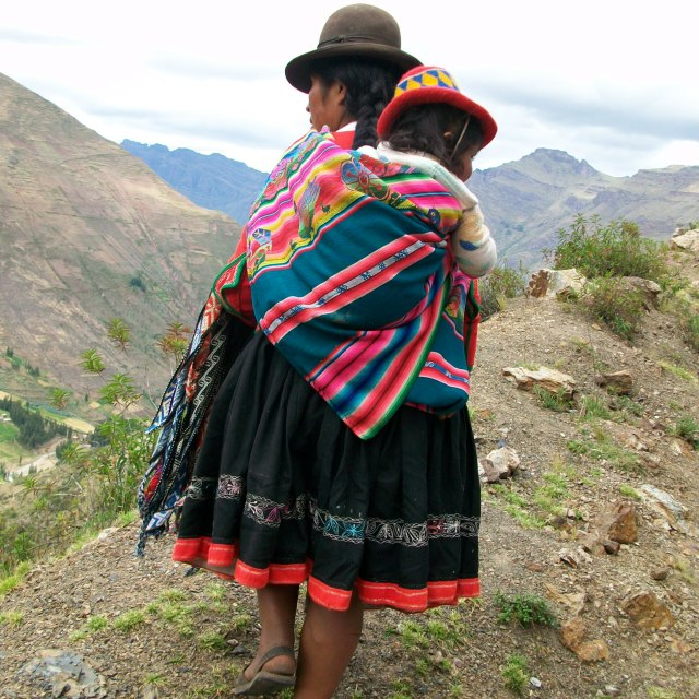 """""""Altiplano Mother carrying child"""" stock image"""