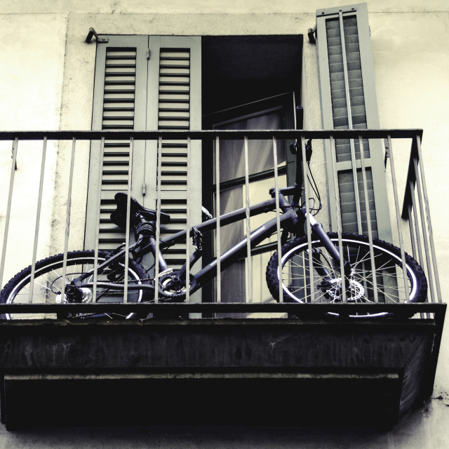 """A bicycle on a balcony"" stock image"