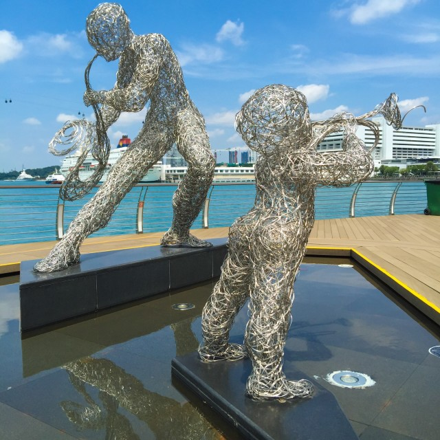 """""""Two stainless musicians at the waterfront"""" stock image"""