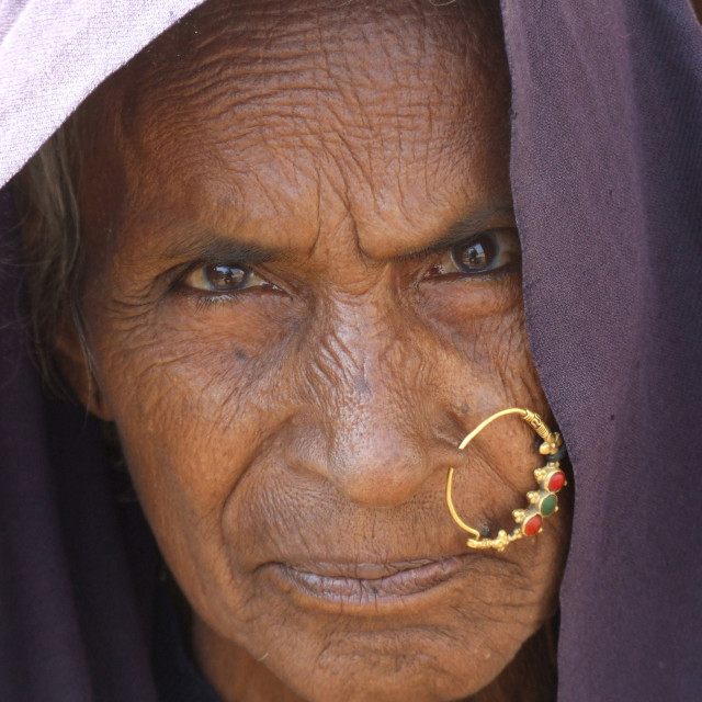 """Old woman of Devpura tribal village, India"" stock image"