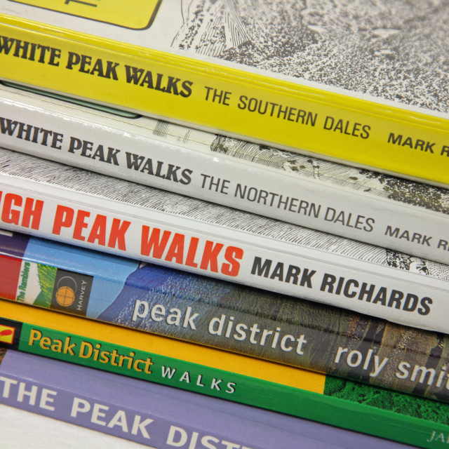 """""""Peak District guide books in a pile"""" stock image"""