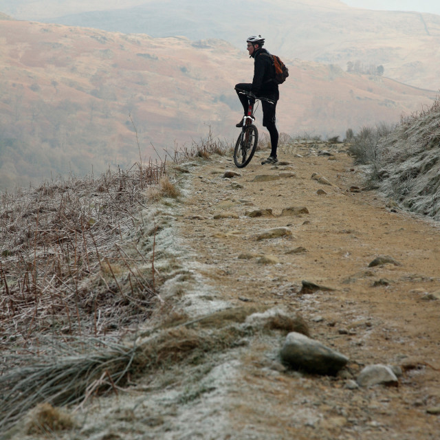 """""""mountain biker English lake district winter"""" stock image"""