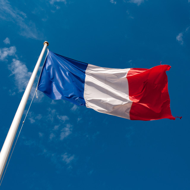 """French flag (tricolor) flying"" stock image"