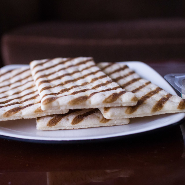 """flatbread on white plate"" stock image"