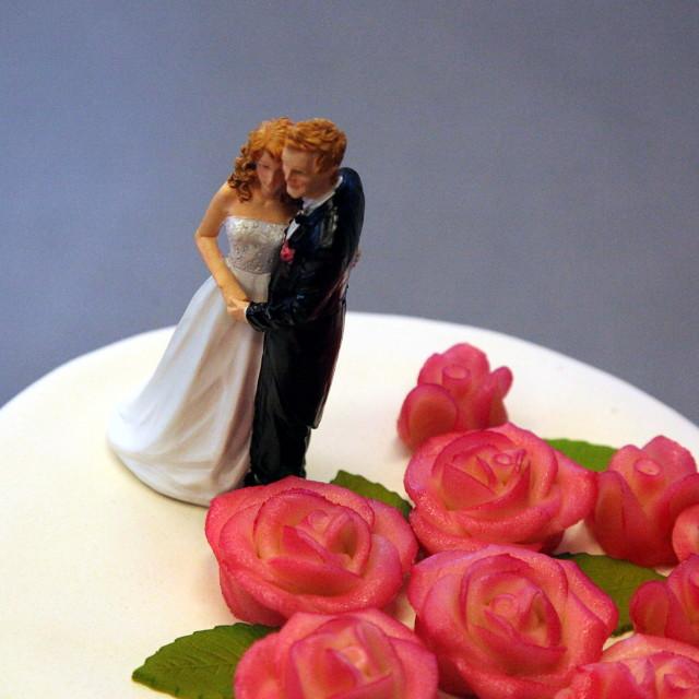 """Couple miniature on wedding cake"" stock image"