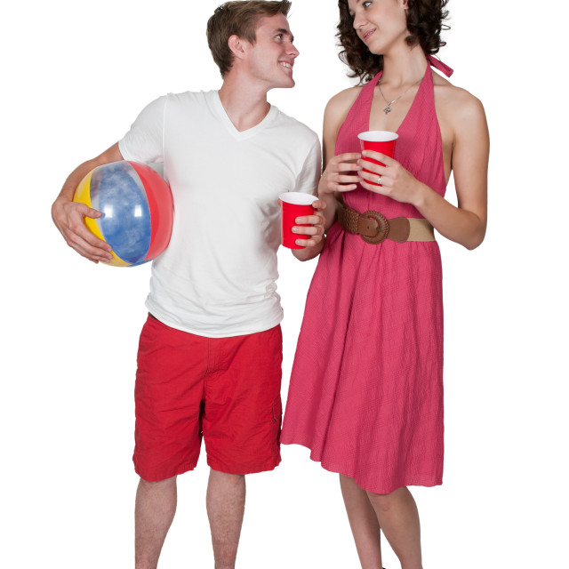 """""""Couple drinking at the beach"""" stock image"""