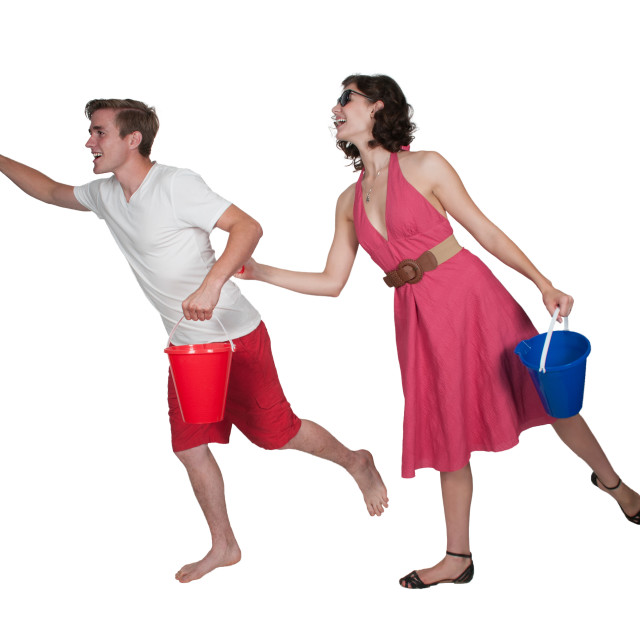 """""""Couple running with a sand pail"""" stock image"""