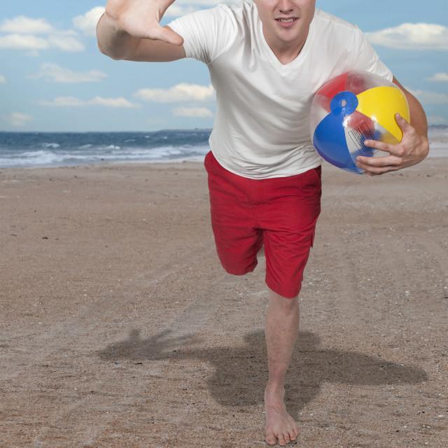 """Man Holding Beach Ball"" stock image"