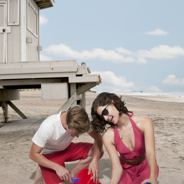 """""""Young Couple with Sand Pails"""" stock image"""