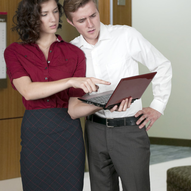 """""""Couple with computer"""" stock image"""