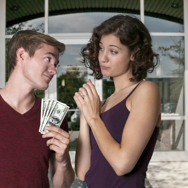 """""""Woman asking for money from a man"""" stock image"""