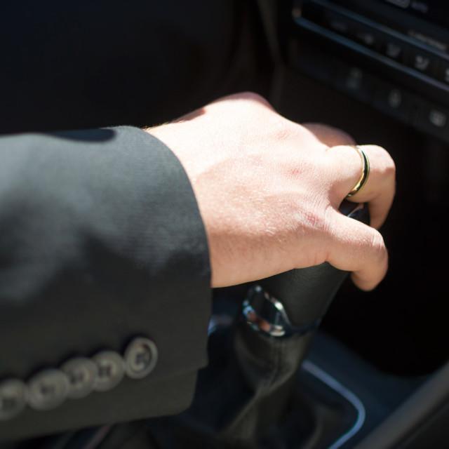 """Groom's Hand on Shift Knob"" stock image"
