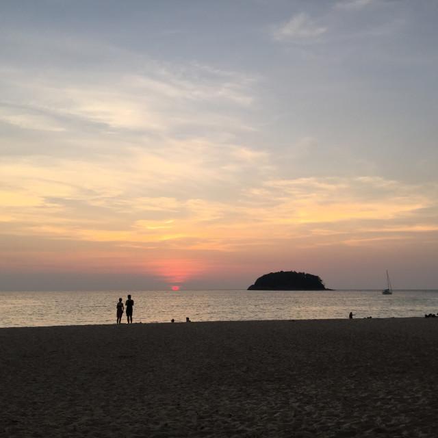 """Kata beach sunset with tourists"" stock image"