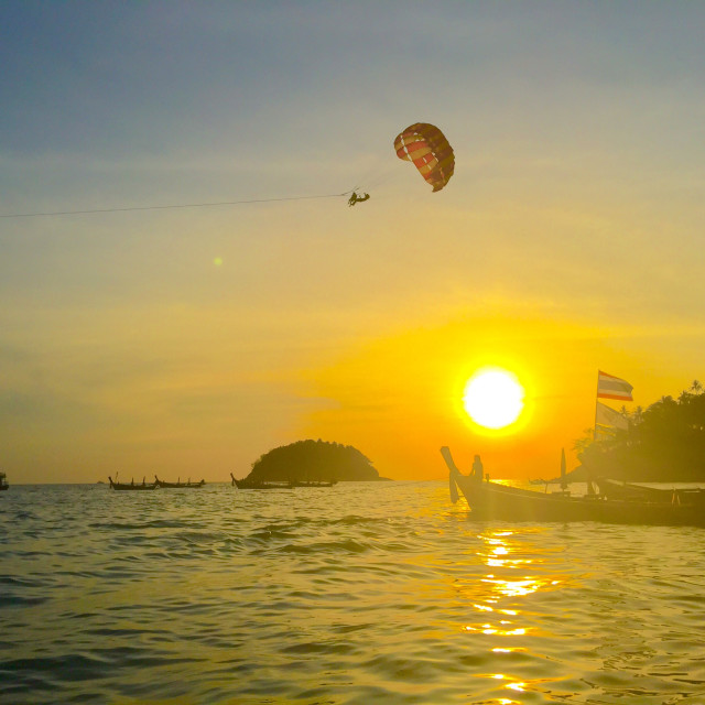 """Kata beach sunset skydiver"" stock image"