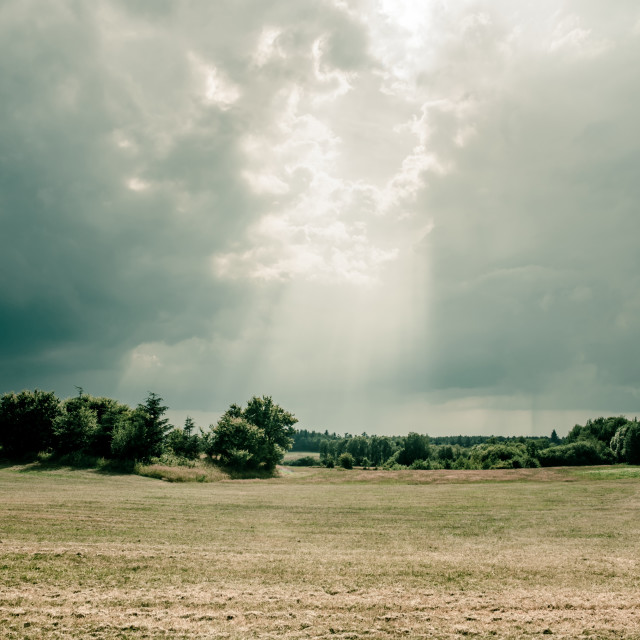 """""""Sunbeams coming through the clouds"""" stock image"""