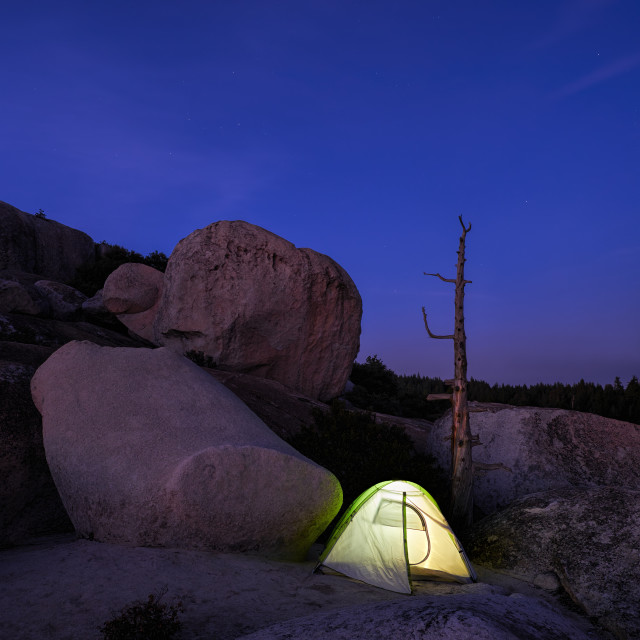 """Camping with a Tent on a Barren Landscape."" stock image"