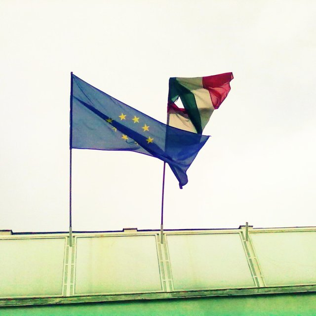 """EU and Hungary flags in stormy weather"" stock image"