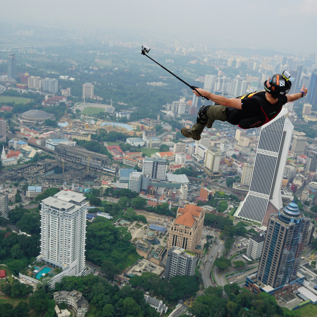 """""""Jump and selfie on the sky"""" stock image"""